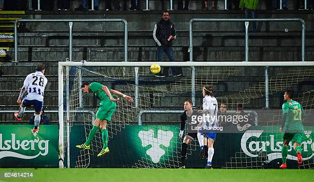 Anders K Jacobsen of OB Odense scores the 10 goal against Goalkeeper Frederik Ronnow of Brondby IF during the Danish Alka Superliga match between OB...
