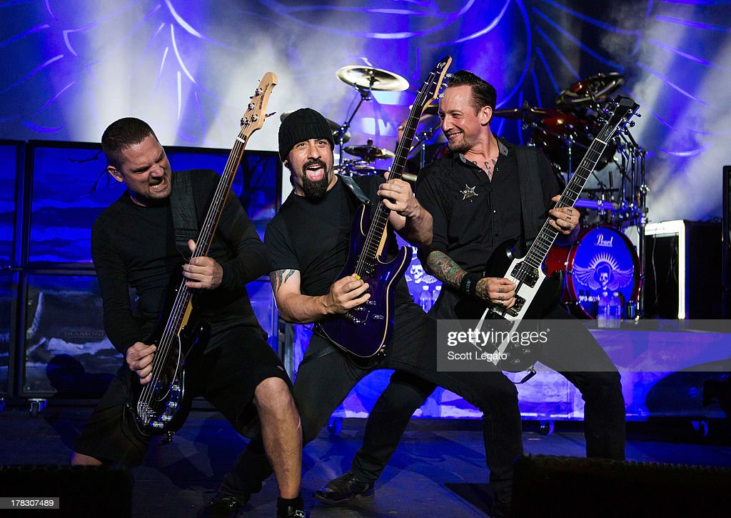 Anders Kjølholm, Rob Caggiano and <a gi-track='captionPersonalityLinkClicked' href=/galleries/search?phrase=Michael+Poulsen&family=editorial&specificpeople=5821230 ng-click='$event.stopPropagation()'>Michael Poulsen</a> of Volbeat performs during the Rock Allegiance Tour at Freedom Hill Amphitheater on August 28, 2013 in Sterling Heights, Michigan.