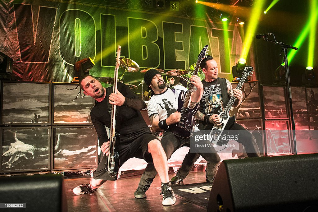 Anders Kjoholm, Rob Caggiano and <a gi-track='captionPersonalityLinkClicked' href=/galleries/search?phrase=Michael+Poulsen&family=editorial&specificpeople=5821230 ng-click='$event.stopPropagation()'>Michael Poulsen</a> from Volbeat perform at Le Bataclan on October 25, 2013 in Paris, France.