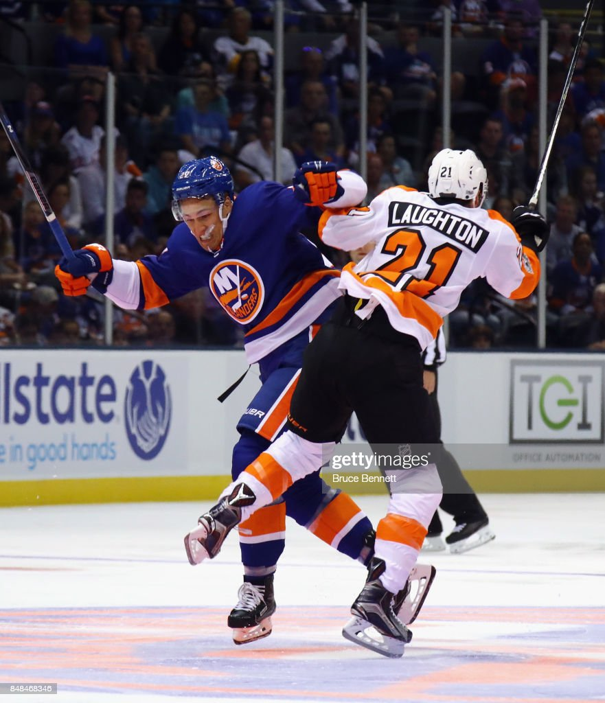 Anders Lee #27 of the New York Islanders and Scott Laughton #21 of the Philadelphia Flyers collide during the first period during a preseason game at the Nassau Veterans Memorial Coliseum on September 17, 2017 in Uniondale, New York.