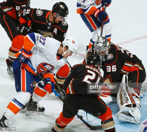 Anders Lee of the New York Islanders battles for the puck against Cam Fowler John Gibson and Chris Wagner of the Anaheim Ducks during the game on...