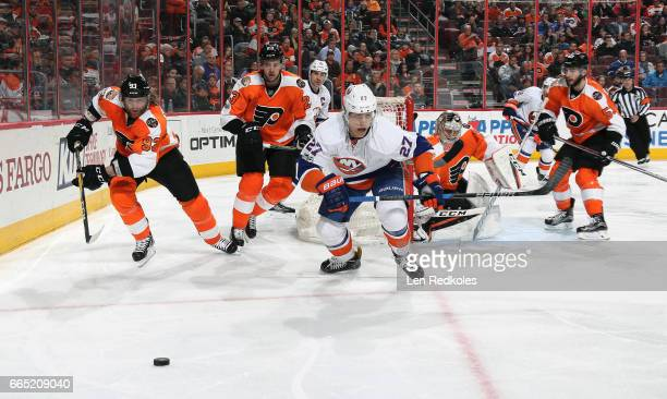 Anders Lee of the New York Islanders skates after the loose puck against Jakub Voracek Brandon Manning Steve Mason and Shayne Gostisbehere of the...