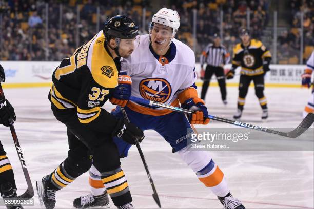 Anders Lee of the New York Islanders skates against Patrice Bergeron of the Boston Bruins at the TD Garden on December 9 2017 in Boston Massachusetts