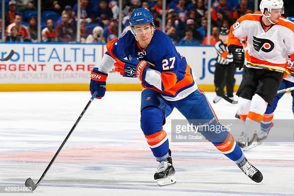 Anders Lee of the New York Islanders skates against the Philadelphia Flyers at Nassau Veterans Memorial Coliseum on November 24 2014 in Uniondale New...