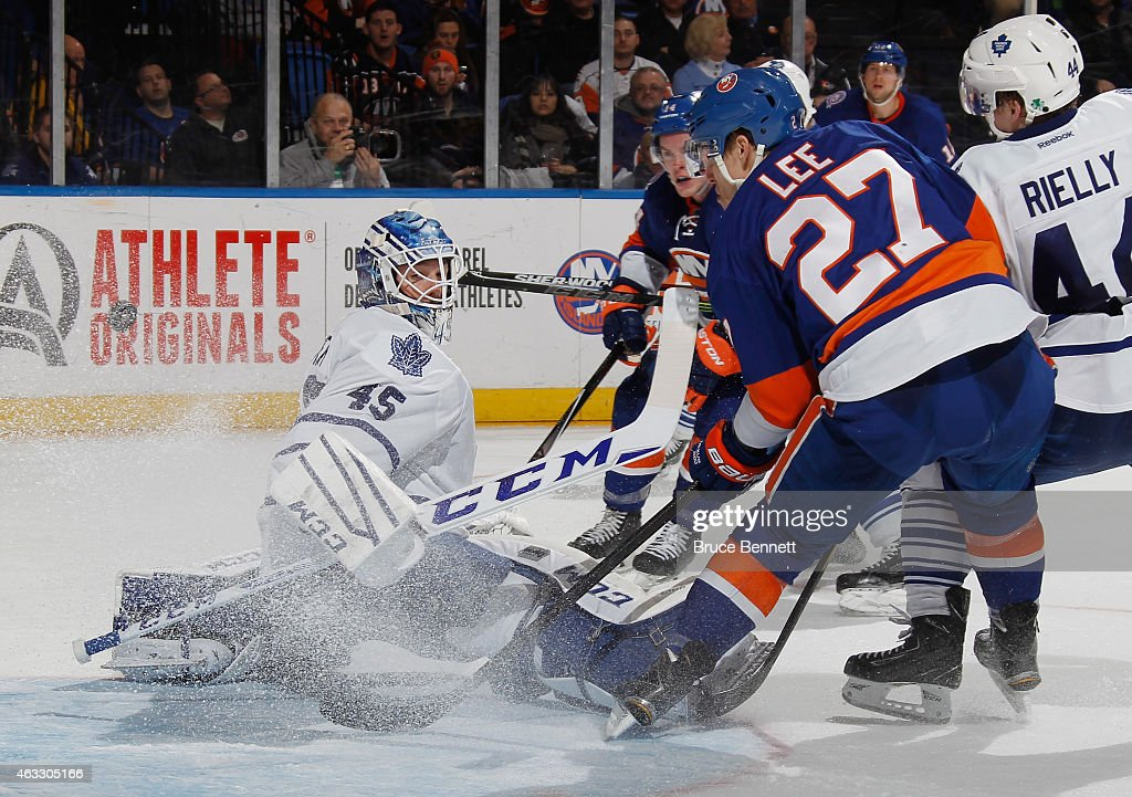 <a gi-track='captionPersonalityLinkClicked' href=/galleries/search?phrase=Anders+Lee&family=editorial&specificpeople=7630081 ng-click='$event.stopPropagation()'>Anders Lee</a> #27 of the New York Islanders, who already had two goals in the game, gets the puck behind <a gi-track='captionPersonalityLinkClicked' href=/galleries/search?phrase=Jonathan+Bernier&family=editorial&specificpeople=540491 ng-click='$event.stopPropagation()'>Jonathan Bernier</a> #45 of the Toronto Maple Leafs but it doesn't go into the net during the second period at the Nassau Veterans Memorial Coliseum on February 12, 2015 in Uniondale, New York.