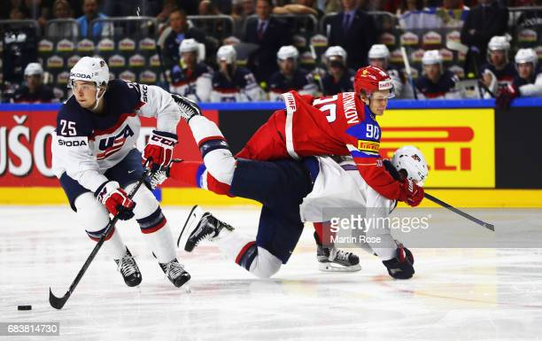 Anders Lee of the USA is smashed by Vladislav Namestnikov of Russia while Charlie McAvoy of the USA controls the puck during the Russia v USA 2017...