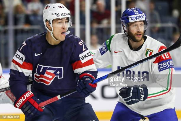 Anders Lee of USA and Giulio Scandella of Italy react during the 2017 IIHF Ice Hockey World Championship game between USA and Italy at Lanxess Arena...