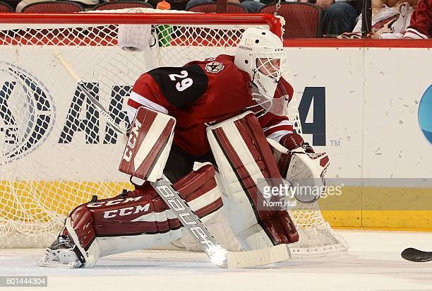 Anders Lindback of the Arizona Coyotes gets ready to make a save against the Minnesota Wild at Gila River Arena on December 11 2015 in Glendale...