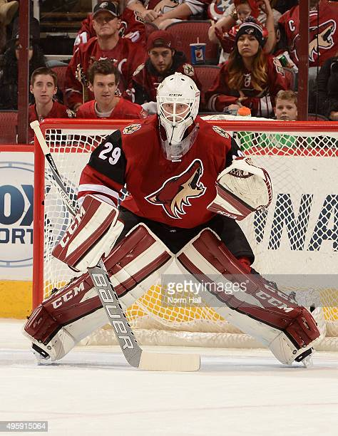 Anders Lindback of the Arizona Coyotes looks to make a save against the Vancouver Canucks at Gila River Arena on October 30 2015 in Glendale Arizona