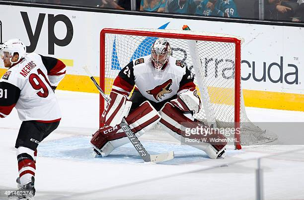 Anders Lindback of the Arizona Coyotes protects the net against the San Jose Sharks at SAP Center on September 25 2015 in San Jose California