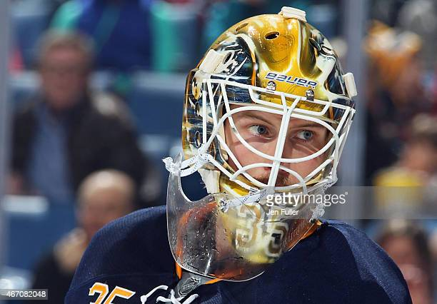 Anders Lindback of the Buffalo Sabres keeps an eye on the play against the New Jersey Devils at First Niagara Center on March 20 2015 in Buffalo New...