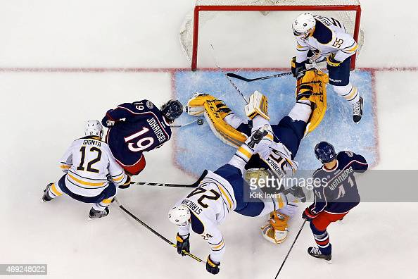 Anders Lindback of the Buffalo Sabres makes a save on a shot by Ryan Johansen of the Columbus Blue Jackets during the first period on April 10 2015...
