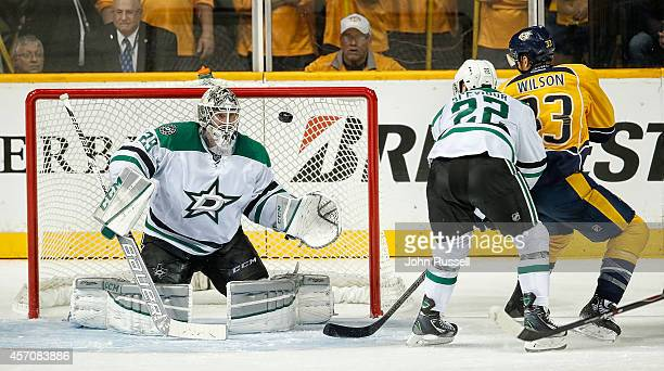 Anders Lindback of the Dallas Stars eyes the shot of Colin Wilson of the Nashville Predators at Bridgestone Arena on October 11 2014 in Nashville...