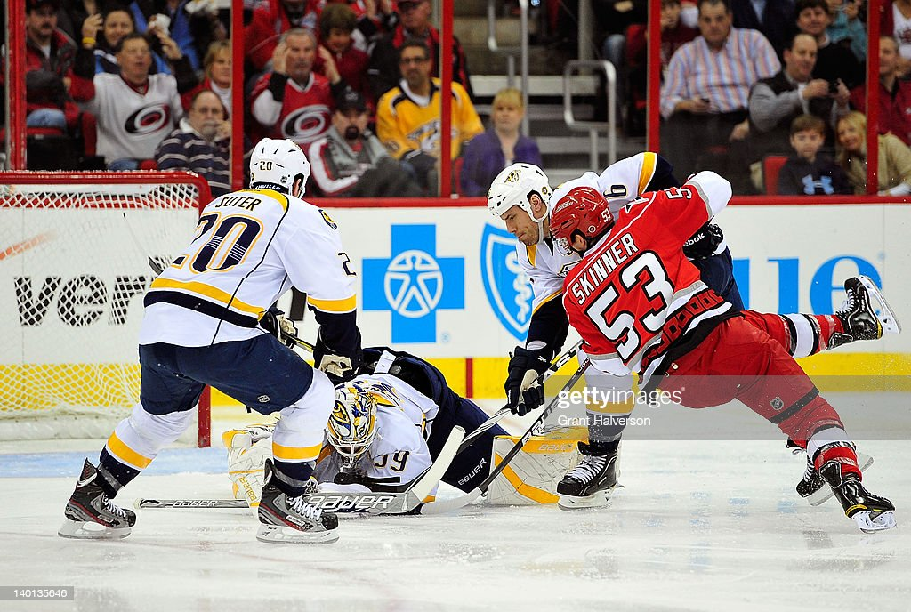 <a gi-track='captionPersonalityLinkClicked' href=/galleries/search?phrase=Anders+Lindback&family=editorial&specificpeople=7211274 ng-click='$event.stopPropagation()'>Anders Lindback</a> #39 of the Nashville Predators stops a point-blank shot by <a gi-track='captionPersonalityLinkClicked' href=/galleries/search?phrase=Jeff+Skinner&family=editorial&specificpeople=3147596 ng-click='$event.stopPropagation()'>Jeff Skinner</a> #53 of the Carolina Hurricanes during play at the RBC Center on February 28, 2012 in Raleigh, North Carolina.