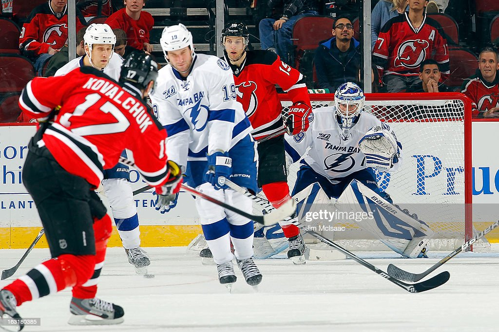 <a gi-track='captionPersonalityLinkClicked' href=/galleries/search?phrase=Anders+Lindback&family=editorial&specificpeople=7211274 ng-click='$event.stopPropagation()'>Anders Lindback</a> #39 of the Tampa Bay Lightning defends his net as <a gi-track='captionPersonalityLinkClicked' href=/galleries/search?phrase=Ilya+Kovalchuk&family=editorial&specificpeople=201796 ng-click='$event.stopPropagation()'>Ilya Kovalchuk</a> #17 of the New Jersey Devils shoots the puck in the third period at the Prudential Center on March 5, 2013 in Newark, New Jersey.