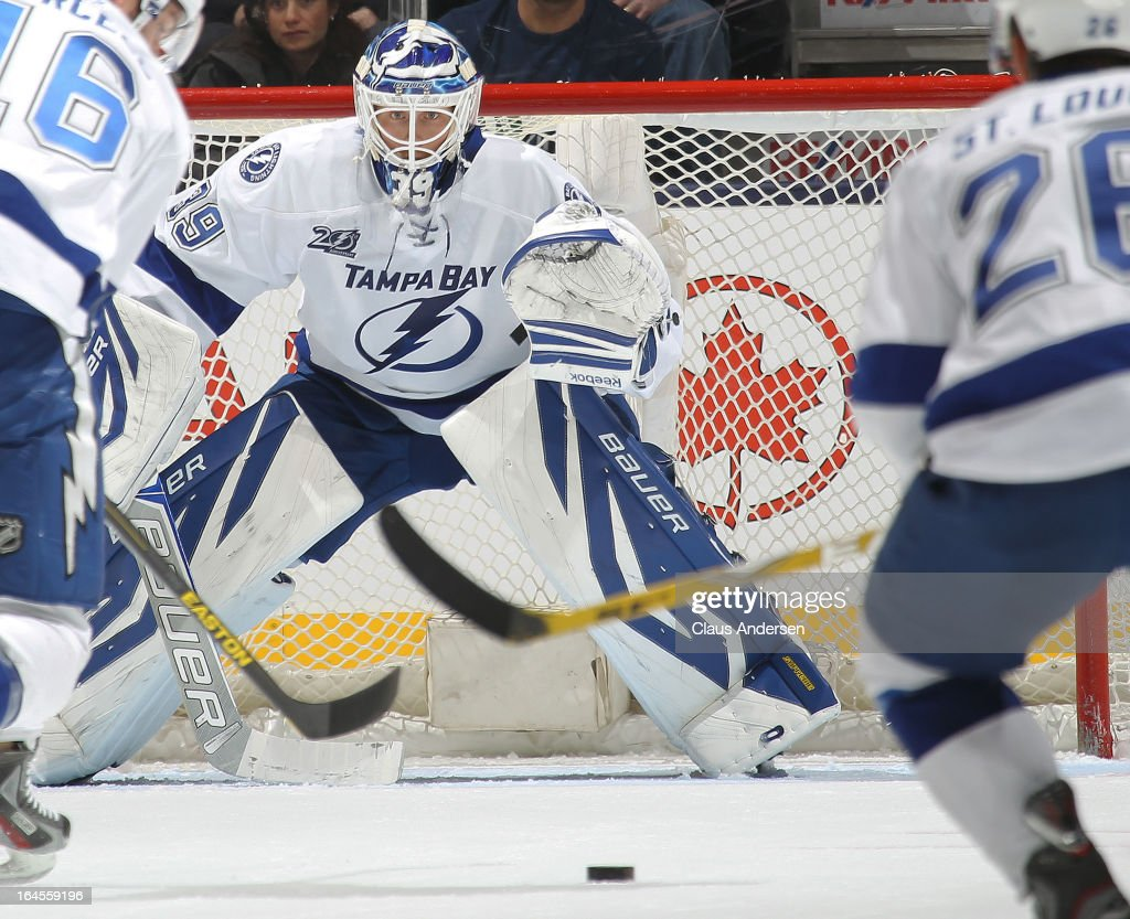 <a gi-track='captionPersonalityLinkClicked' href=/galleries/search?phrase=Anders+Lindback&family=editorial&specificpeople=7211274 ng-click='$event.stopPropagation()'>Anders Lindback</a> #39 of the Tampa Bay Lightning keeps an eye on the puck in a game against the Toronto Maple Leafs on March 20, 2013 at the Air Canada Centre in Toronto, Ontario, Canada. The Leafs defeated the Lightning 4-2.