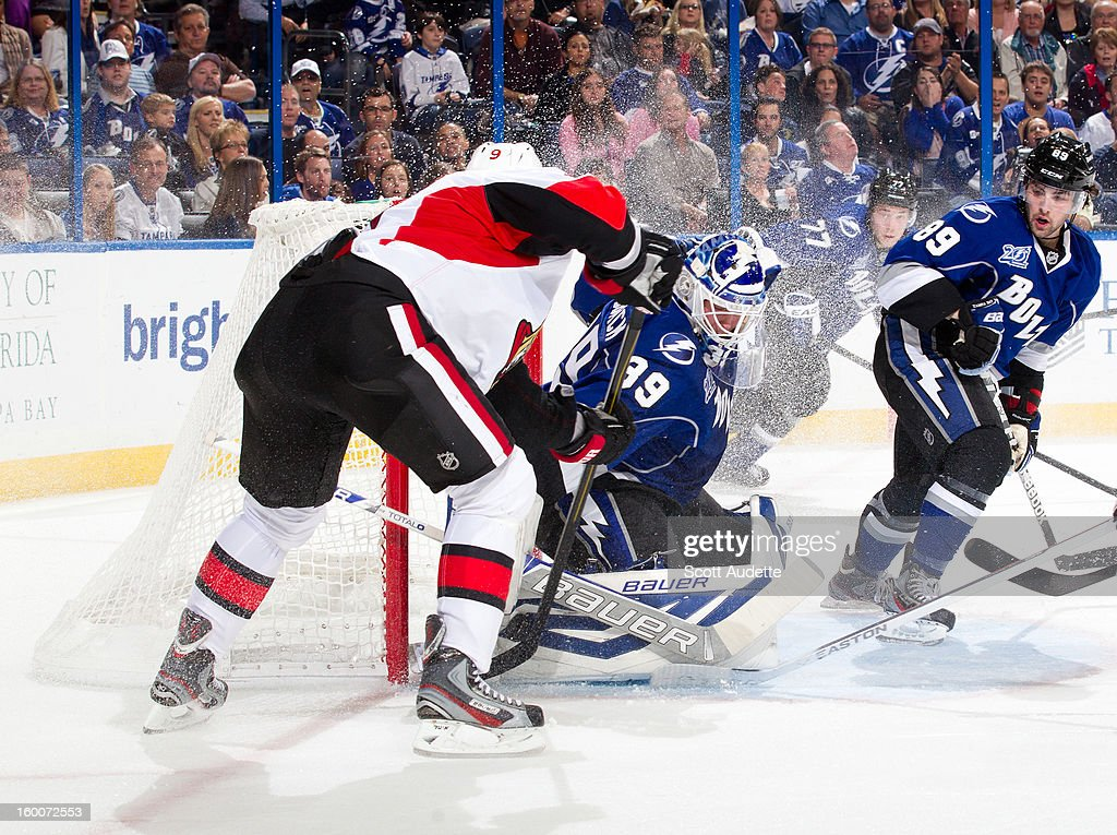 Anders Lindback #39 of the Tampa Bay Lightning makes a save against <a gi-track='captionPersonalityLinkClicked' href=/galleries/search?phrase=Milan+Michalek&family=editorial&specificpeople=544987 ng-click='$event.stopPropagation()'>Milan Michalek</a> #9 of the Ottawa Senators during the second period at the Tampa Bay Times Forum on January 25, 2013 in Tampa, Florida.
