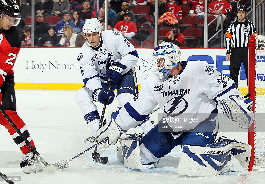 <a gi-track='captionPersonalityLinkClicked' href=/galleries/search?phrase=Anders+Lindback&family=editorial&specificpeople=7211274 ng-click='$event.stopPropagation()'>Anders Lindback</a> #39 of the Tampa Bay Lightning makes a save against the New Jersey Devils at the Prudential Center on February 7, 2013 in Newark, New Jersey.