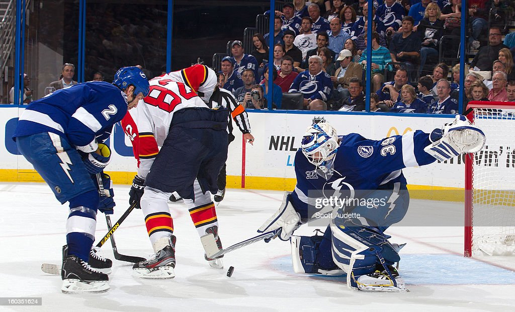 <a gi-track='captionPersonalityLinkClicked' href=/galleries/search?phrase=Anders+Lindback&family=editorial&specificpeople=7211274 ng-click='$event.stopPropagation()'>Anders Lindback</a> #39 of the Tampa Bay Lightning makes a save in front of <a gi-track='captionPersonalityLinkClicked' href=/galleries/search?phrase=Eric+Brewer&family=editorial&specificpeople=202144 ng-click='$event.stopPropagation()'>Eric Brewer</a> #2 and <a gi-track='captionPersonalityLinkClicked' href=/galleries/search?phrase=Tomas+Kopecky&family=editorial&specificpeople=2234349 ng-click='$event.stopPropagation()'>Tomas Kopecky</a> #82 of the Florida Panthers at the Tampa Bay Times Forum on January 29, 2013 in Tampa, Florida.