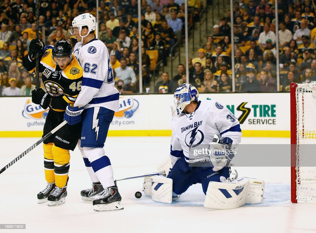 <a gi-track='captionPersonalityLinkClicked' href=/galleries/search?phrase=Anders+Lindback&family=editorial&specificpeople=7211274 ng-click='$event.stopPropagation()'>Anders Lindback</a> #39 of the Tampa Bay Lightning makes a save in front of <a gi-track='captionPersonalityLinkClicked' href=/galleries/search?phrase=David+Krejci&family=editorial&specificpeople=722556 ng-click='$event.stopPropagation()'>David Krejci</a> #46 of the Boston Bruins in the third period during the home opener game on October 3, 2013 at TD Garden in Boston, Massachusetts.