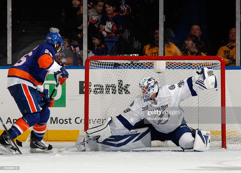 Anders Lindback #39 of the Tampa Bay Lightning skates against the New York Islanders at the Nassau Veterans Memorial Coliseum on January 21, 2013 in Uniondale, New York.