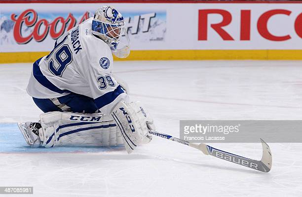 Anders Lindback of the Tampa Bay Lightning stops a shot during the game against the Montreal Canadiens in Game Four of the First Round of the 2014...
