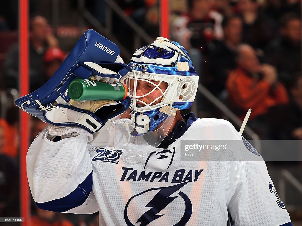 Anders Lindback #39 of the Tampa Bay Lightning takes some water during a time out against the Philadelphia Flyers on February 5, 2013 at the Wells Fargo Center in Philadelphia, Pennsylvania.