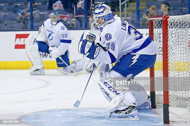 Anders Lindback of the Tampa Bay Lightning warms up prior to the start of the game against the Columbus Blue Jackets on January 13 2014 at Nationwide...