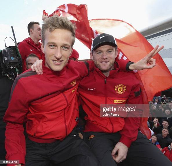 Anders Lindegaard and Wayne Rooney of Manchester United pose on their Barclays Premier League Trophy Parade through Manchester on May 13 2013 in...