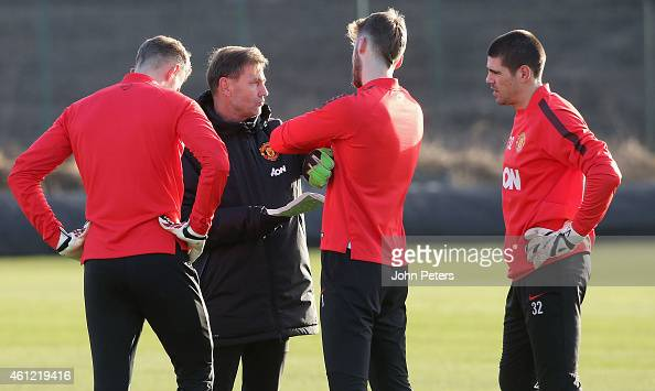 Anders Lindegaard David de Gea and Victor Valdes of Manchester United speak to Goalkeeping Coach Frans Hoek during a first team training session at...