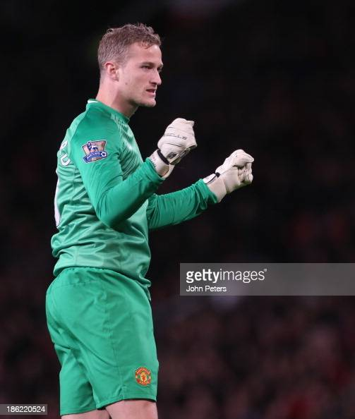 Anders Lindegaard of Manchester United celebrates Javier 'Chicharito' Hernandez scoring their second goal during the Capital One Cup Fourth Round...