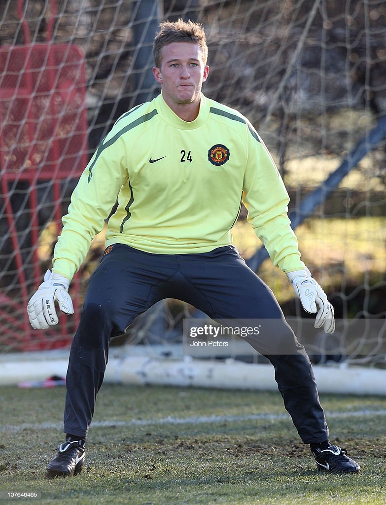 <a gi-track='captionPersonalityLinkClicked' href=/galleries/search?phrase=Anders+Lindegaard&family=editorial&specificpeople=7243148 ng-click='$event.stopPropagation()'>Anders Lindegaard</a> of Manchester United in action during a first team training session at Carrington Training Ground on December 17, 2010 in Manchester, England.