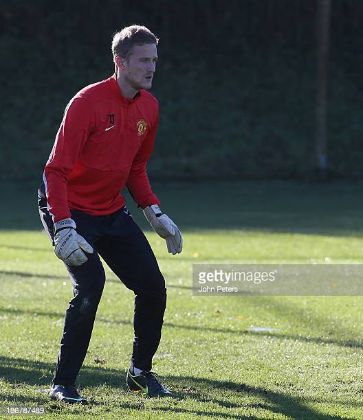 Anders Lindegaard of Manchester United in action during a first team training session ahead of their UEFA Champions League Group A match against Real...