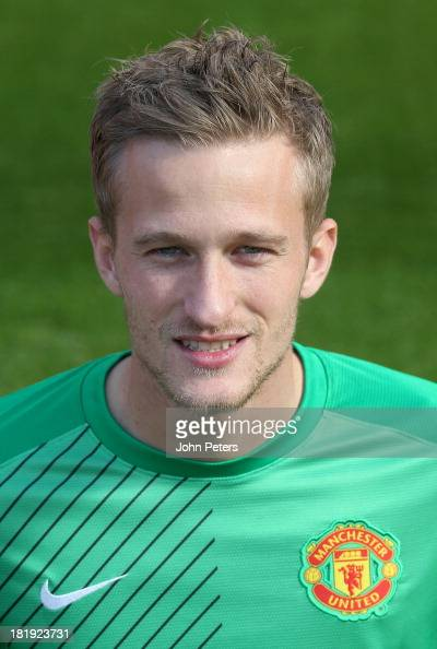 Anders Lindegaard of Manchester United poses at the annual club photocall at Old Trafford on September 26 2013 in Manchester England