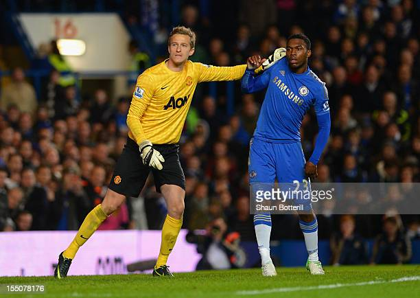 Anders Lindegaard of Manchester United pushes Daniel Sturridge of Chelsea as they wait for a corner during the Capital One Cup Fourth Round match...