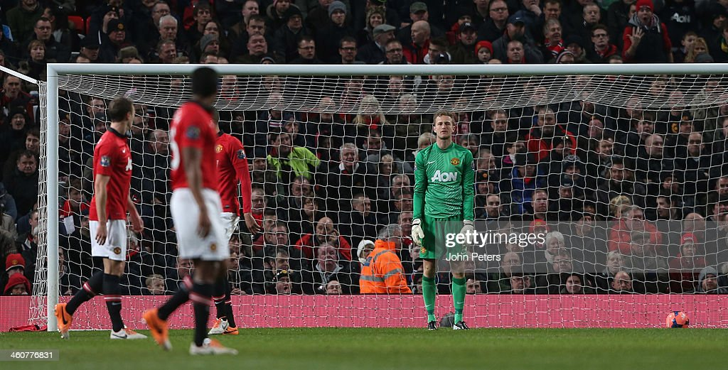 <a gi-track='captionPersonalityLinkClicked' href=/galleries/search?phrase=Anders+Lindegaard&family=editorial&specificpeople=7243148 ng-click='$event.stopPropagation()'>Anders Lindegaard</a> of Manchester United reacts to conceding a goal to Wayne Routledge of Swansea City during the FA Cup Third Round match between Manchester United and Swansea City at Old Trafford on January 5, 2014 in Manchester, England.