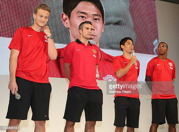 Anders Lindegaard Robin van Persie Shinji Kagawa and Ashley Young of Manchester United pose at a press event for Yanmar on July 25 2013 in Osaka Japan