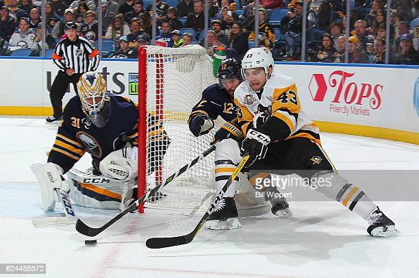 Anders Nilsson and Brian Gionta of the Buffalo Sabres defend against Conor Sheary of the Pittsburgh Penguins during an NHL game at the KeyBank Center...