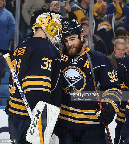 Anders Nilsson and Ryan O'Reilly of the Buffalo Sabres celebrate after their 30 win against the Florida Panthers in an NHL game at the KeyBank Center...