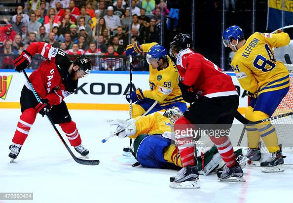 Anders Nilsson goaltender of Sweden blocks a shot of Ryan O'Reilly of Canada during the IIHF World Championship group A match between Sweden and...