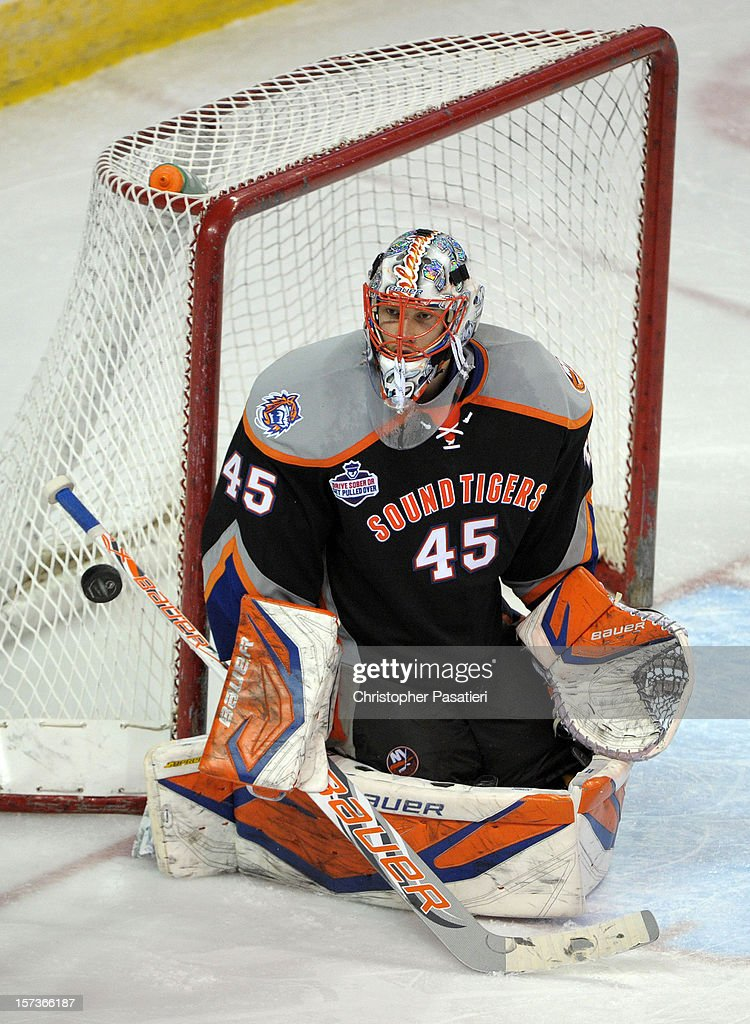 Anders Nilsson #45 of the Bridgeport Sound Tigers looks at a deflected shot on goal during an American Hockey League game against the Norfolk Admirals on December 2, 2012 at the Webster Bank Arena in Bridgeport, Connecticut. The Admirals defeated the Sound Tigers 4-1.