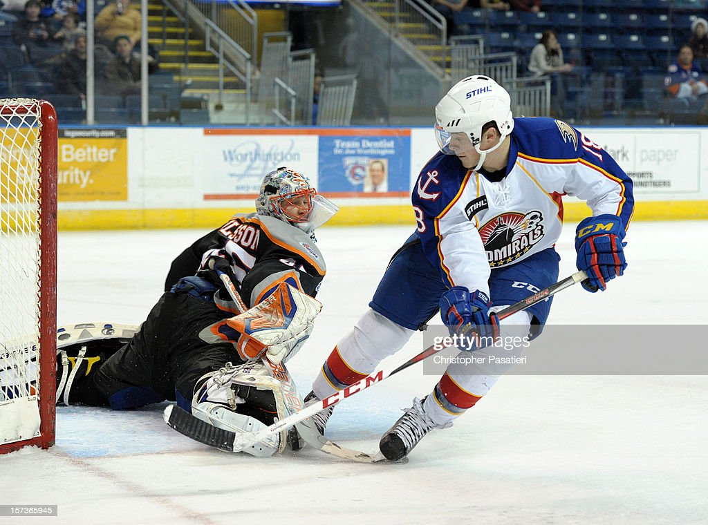 Anders Nilsson of the Bridgeport Sound Tigers stops a shot on goal by Chris Wagner of the Norfolk Admirals during an American Hockey League game on...