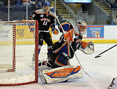 Anders Nilsson of the Bridgeport Sound Tigers watches the game action during an American Hockey League game against the Norfolk Admirals on December...