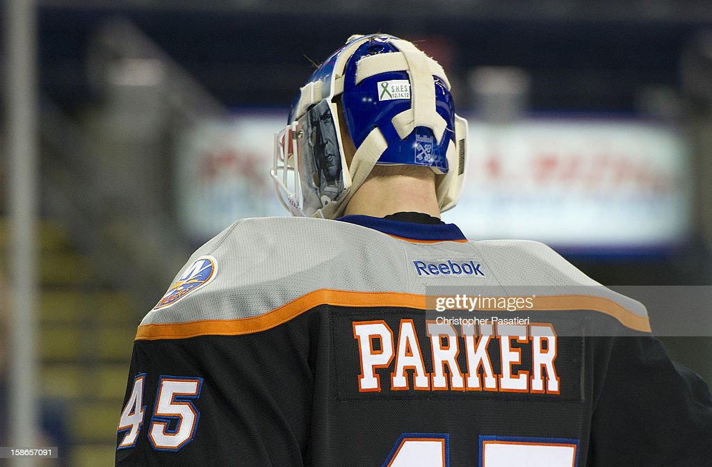 Anders Nilsson #45 of the Bridgeport Sound Tigers wears the name of Sandy Hook Elementary School shooting victim Emilie Parker on the back of his jersey as part of a tribute during an American Hockey League game against the Adirondack Phantoms on December 22, 2012 at the Webster Bank Arena at Harbor Yard in Bridgeport, Connecticut.