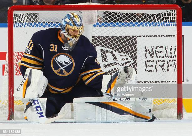 Anders Nilsson of the Buffalo Sabres makes a first period save against the San Jose Sharks during an NHL game at the KeyBank Center on February 7...