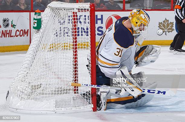 Anders Nilsson of the Buffalo Sabres makes a save against the Ottawa Senators at Canadian Tire Centre on November 29 2016 in Ottawa Ontario Canada