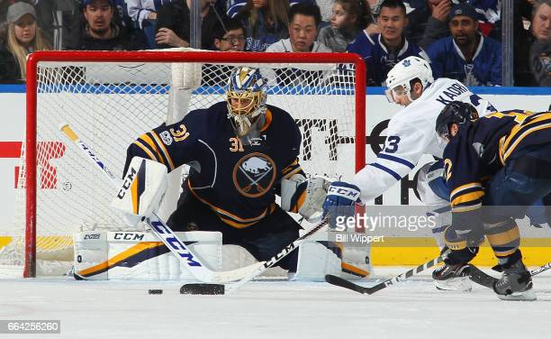 Anders Nilsson of the Buffalo Sabres makes a third period save against Nazem Kadri of the Toronto Maple Leafs during an NHL game at the KeyBank...