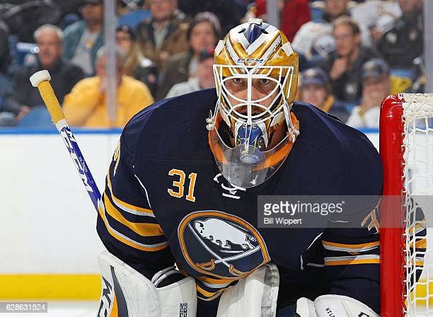 Anders Nilsson of the Buffalo Sabres tends goal against the Edmonton Oilers during an NHL game at the KeyBank Center on December 6 2016 in Buffalo...