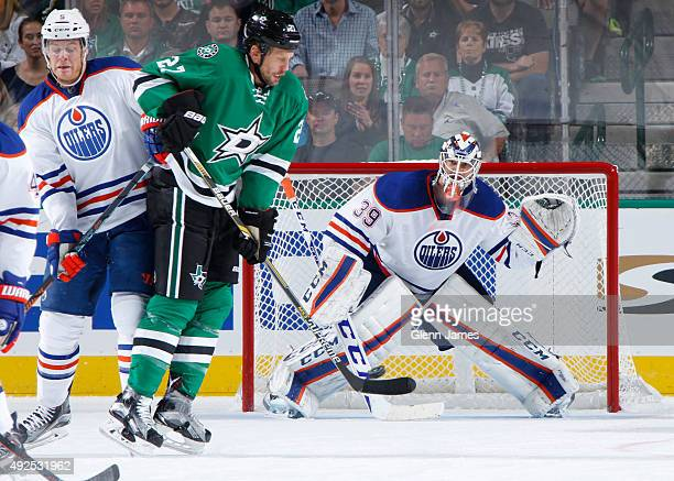 Anders Nilsson of the Edmonton Oilers attempts to track a redirect from Travis Moen of the Dallas Stars at the American Airlines Center on October 13...