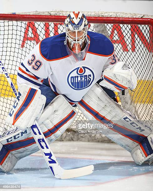 Anders Nilsson of the Edmonton Oilers faces a shot during the warmup prior to play against the Toronto Maple Leafs in an NHL game at Air Canada...